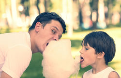 Kids eating cotton candy Royalty Free Stock Images