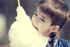 Kids eating cotton candy Royalty Free Stock Photo