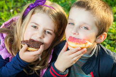 Kids eating donuts Stock Photo