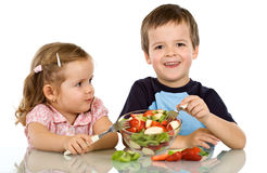Kids eating fruit salad Stock Photography