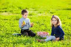 Kids eating fruits Stock Photography