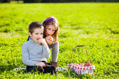 Kids eating fruits Stock Images
