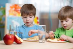 Kids eating healthy food at home. Or kindergarten Royalty Free Stock Image