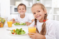 Kids eating a healthy meal stock images