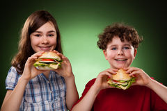 Kids eating healthy sandwiches Stock Photos