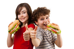 Kids eating healthy sandwiches Stock Images