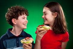 Kids eating healthy sandwiches Royalty Free Stock Photo