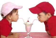 Kids eating ice cream royalty free stock photos