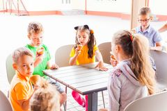 Kids eating ice cream royalty free stock photos