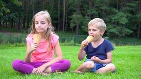 Kids eating icecream outdoors stock video footage