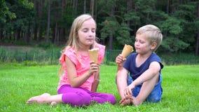 Kids eating icecream outdoors stock video