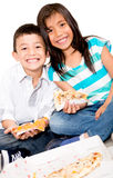 Kids eating pizza Stock Image