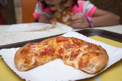Kids eating pizza Stock Photography