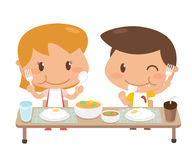 Kids are eating together. Royalty Free Stock Photo