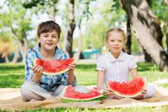 Kids eating watermelon Royalty Free Stock Photos