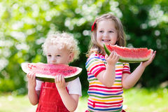Kids eating watermelon in the garden Royalty Free Stock Photography
