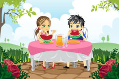 Kids eating watermelon in a park Royalty Free Stock Image
