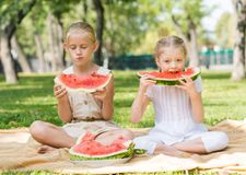 Kids eating watermelon Stock Images