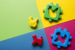 Kids educational developing toys frame on colorful background. Top view. Flat lay. Copy space for text stock photos