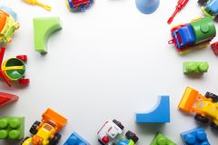 Kids educational developing toys frame on white background. Top view. Flat lay. Copy space for text.  Royalty Free Stock Image