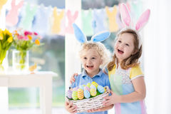Kids with eggs basket on Easter egg hunt Royalty Free Stock Photo