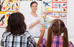 Kids in elementary science class Stock Images