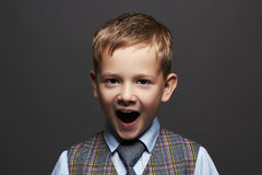 Kids emotion.fashionable little boy.stylish funny child in suit and tie Stock Photography