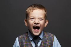 Kids emotion.fashionable little boy.stylish funny child in suit and tie Royalty Free Stock Images