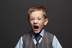 Kids emotion.fashionable little boy.stylish funny child in suit and tie Stock Image