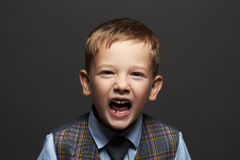 Kids emotion.fashionable little boy.stylish funny child in suit and tie Stock Photos