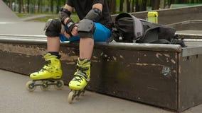 Kid energy extreme sport hobby roller resting stock video
