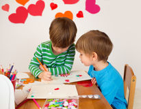 Kids engaged in Valentine's Day Arts with Hearts Royalty Free Stock Photo
