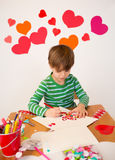 Kids engaged in Valentine's Day Arts with Hearts Royalty Free Stock Photos