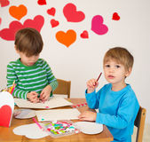 Kids engaged in Valentine's Day Arts with Hearts Royalty Free Stock Images