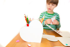 Kids engaged in Valentine's Day Arts with Hearts Stock Photos
