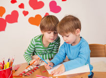 Kids engaged in Valentine's Day Arts with Hearts Stock Image