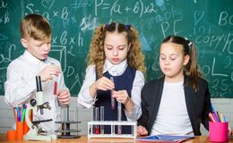 Kids enjoy chemical experiment. Chemical substance dissolves in another. Exploring is so exciting. Chemical reaction. Occurs when substance change into new royalty free stock images