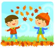 Kids enjoying autumn. Cute kids playing with autumn leaves Stock Image