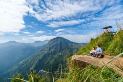 Ella gap views. Kids enjoying breathtaking views over mountains and tea plantations from Little Adams peak in Ella Sri Lanka stock image