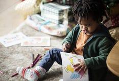 Kids enjoying the coloring book Royalty Free Stock Image