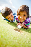 Kids enjoying golf Stock Photo