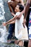 Kids enjoying and having fun with Ravana waterfall, Sri Lanka stock images