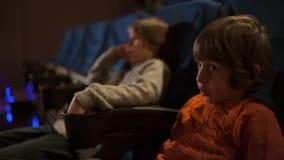 Kids enjoying movie at cinema. Two little brothers enjoying movie at cinema stock video