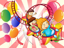 Kids enjoying the roller coaster ride Stock Images