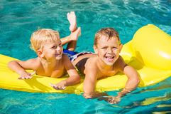 Kids Enjoying Summer Day at the Pool Stock Photo