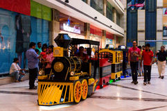 Kids enjoying toy train ride. DELHI, INDIA, 22ND OCTOBER 2016 - Kids enjoying a toy train ride in a mall in Delhi Gurgaon. Many such entertainment options have Stock Image