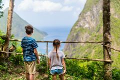 Kids enjoying view of Piton mountains. Back view of kids brother and sister enjoying scenery of Piton mountains on St Lucia island in Caribbean stock images