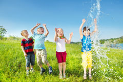 Kids enjoying water splashes Royalty Free Stock Photo