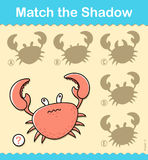 Kids entertaining puzzle game with a red crab Stock Photography