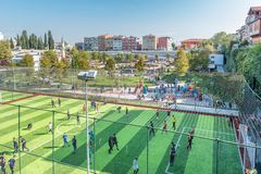 Kids exercising before match on soccer field or football court stock image